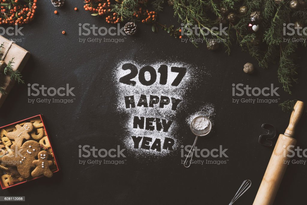 Happy new year text written with powder sugar 2017 stock photo