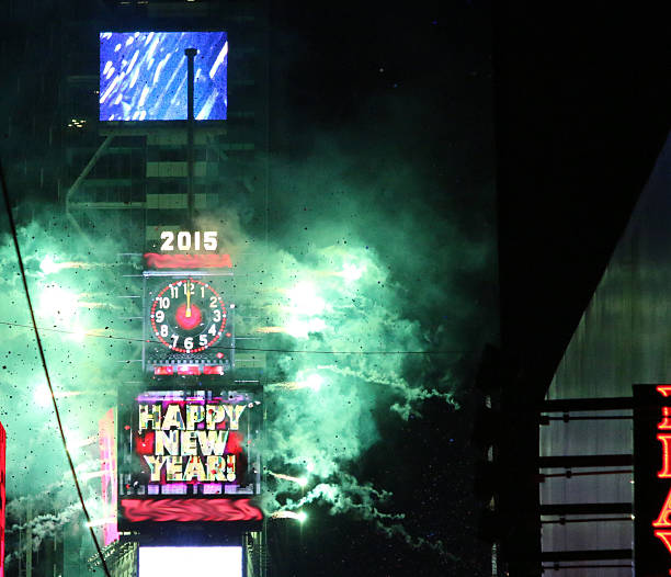 happy new year times square 2015 - times square stock photos and pictures