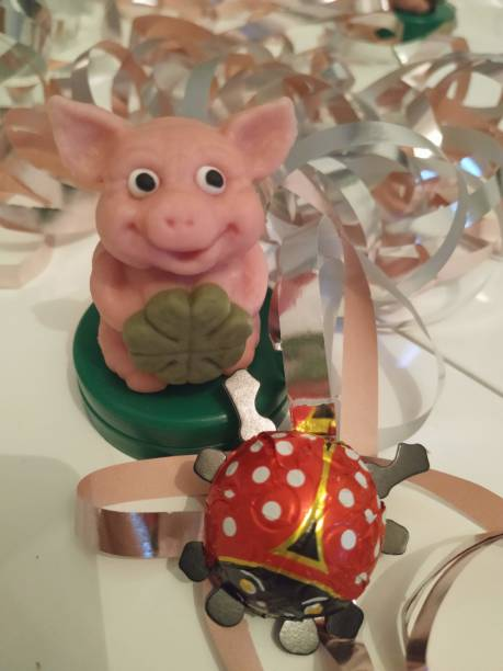 Happy New Year with a marzipan pig stock photo