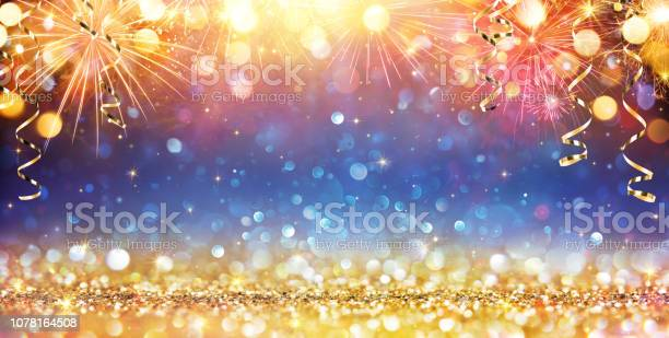 Happy new year with glitter and fireworks picture id1078164508?b=1&k=6&m=1078164508&s=612x612&h=j hqjhazzmze6lp1d qrkypzd9ngwcfaj8zoeufqgos=