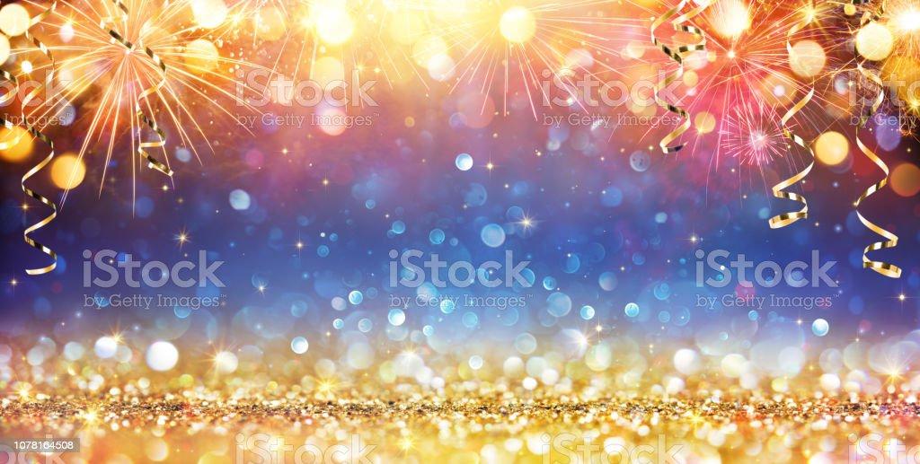 Happy New Year avec paillettes et feux d'artifice - Photo