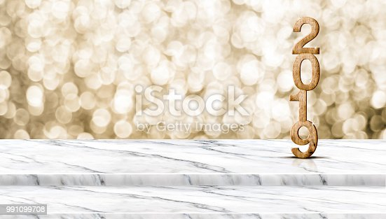 istock Happy new year wood 2019 number (3d rendering ) on step white marble table with sparkling gold bokeh wall,banner for display of product for holiday celebration promotion and advertise for online content. 991099708