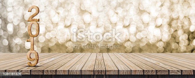 1018565666istockphoto 2019 happy new year wood number (3d rendering) on wood table with sparkling gold bokeh wall,leave space for display or montage of design or content. 1034181324