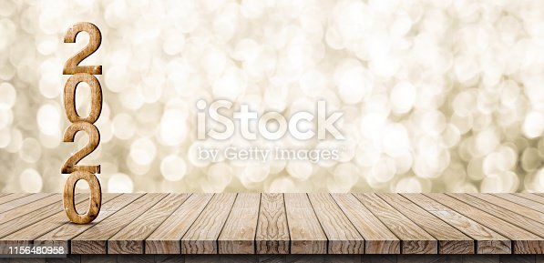 istock 2020 happy new year wood number (3d rendering) on wood table with sparkling gold bokeh wall,leave space for display or montage of design or content 1156480958