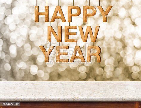 istock Happy New Year wood texture with sparkle star hang on marble table with sparkling gold bokeh wall,winter festive holiday celebration greeting card. 899027242