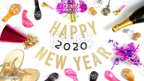istock Happy New Year's Eve banner with champagne and pink and gold party decorations. 1181929264