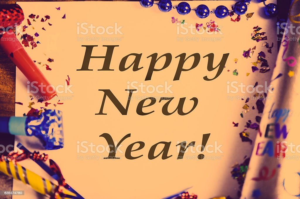 Happy New Year\'s message on page with party decorations around the...