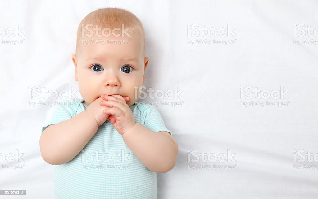 Charmant Happy Newborn Baby On Bed Stock Photo