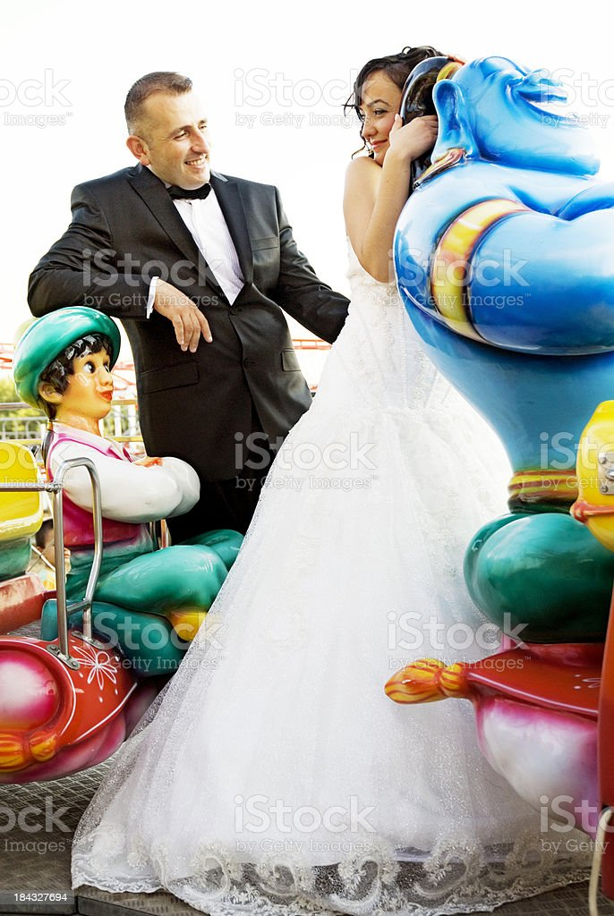 Happy Newlywed Couple in Amusement Park royalty-free stock photo
