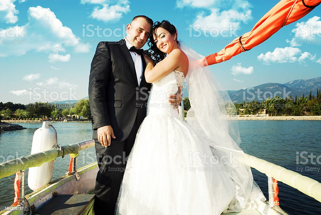 Happy newlywed couple on the boat royalty-free stock photo