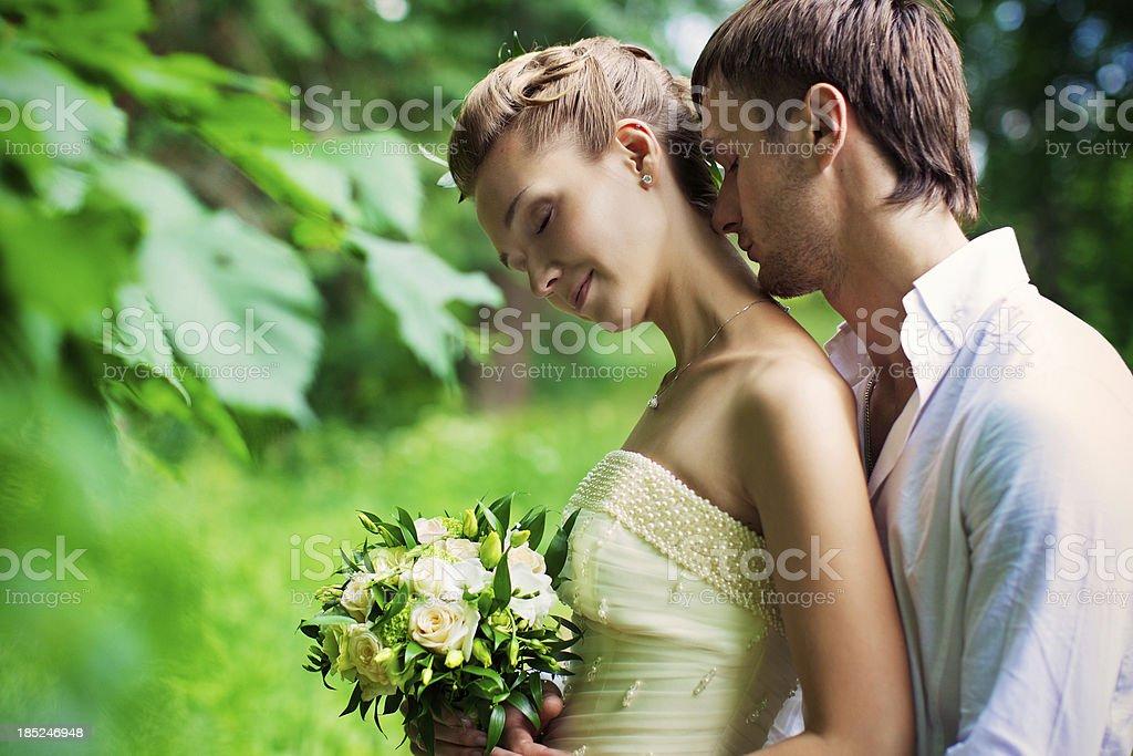 Happy newlyweds among the foliage. Tenderness, sensuality, love, beauty royalty-free stock photo