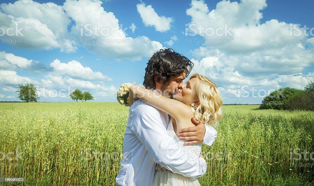 Happy Newlyweds Kissing royalty-free stock photo