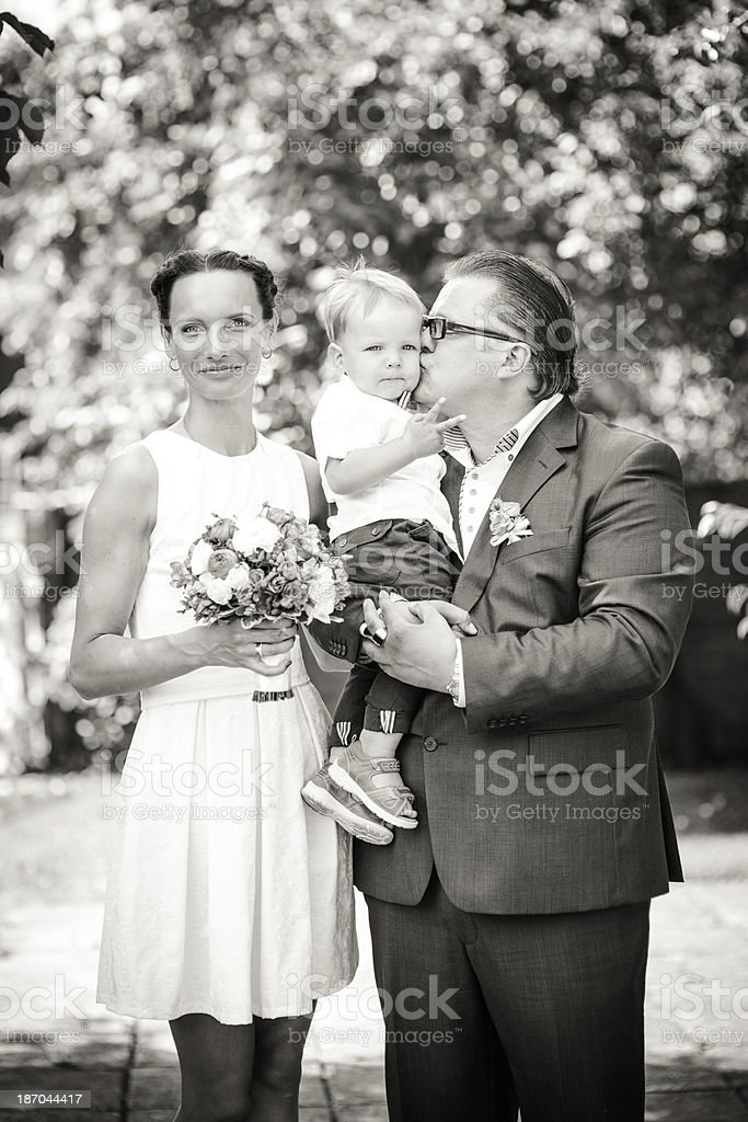 Happy Newlyweds with their son royalty-free stock photo