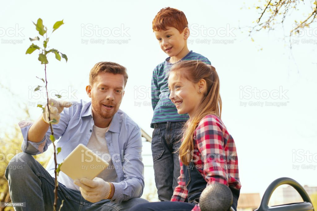 Happy nice children listening to their father royalty-free stock photo