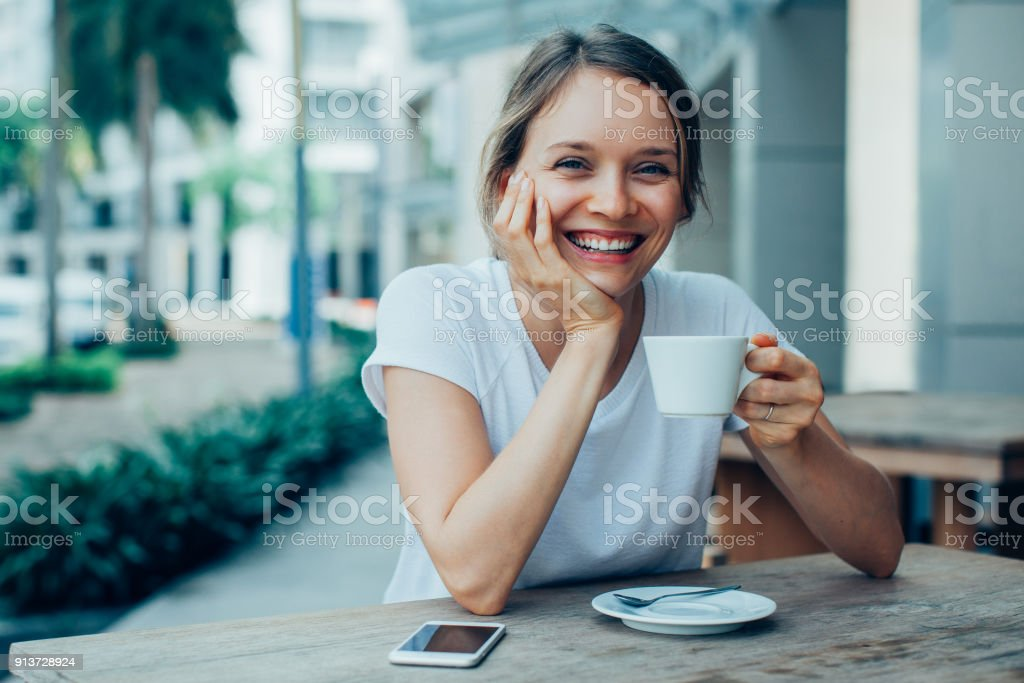 Happy Nice Lady Drinking Coffee in Outdoor Cafe royalty-free stock photo