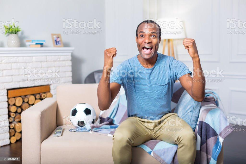 Happy nice man feeling excited stock photo