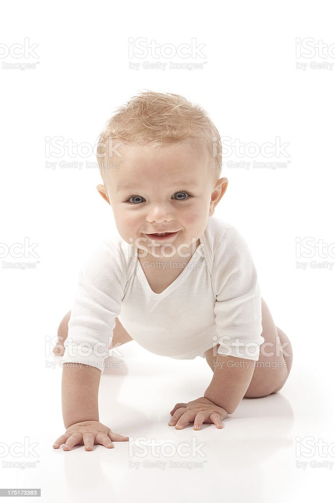 Happy Nine Month Old Baby Crawling on White Background royalty-free stock photo