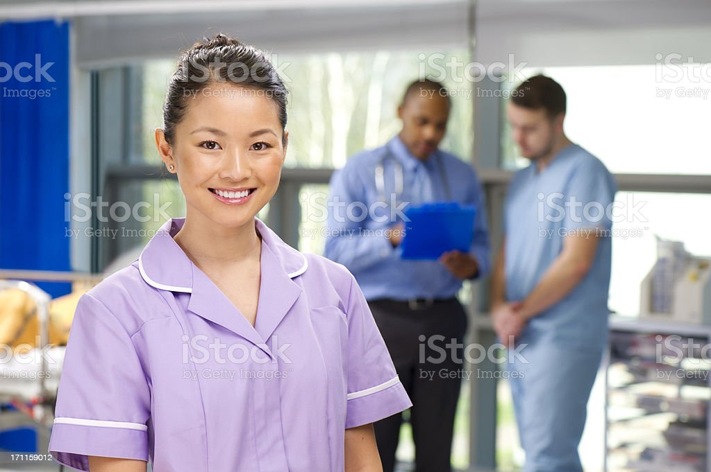 happy nurse on a busy ward royalty-free stock photo