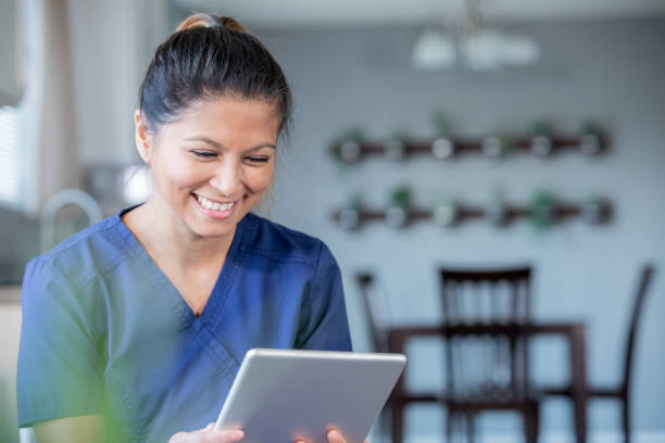 happy nurse or doctor video chatting with patients while working from home - telemedicine stock pictures, royalty-free photos & images