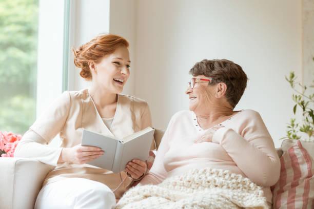 Happy nurse reading a funny book to her elderly patient in a private picture id997290014?b=1&k=6&m=997290014&s=612x612&w=0&h=cuhvw47m4o  u7bk4m4a68crwbath9jv3ccl2u7awc0=