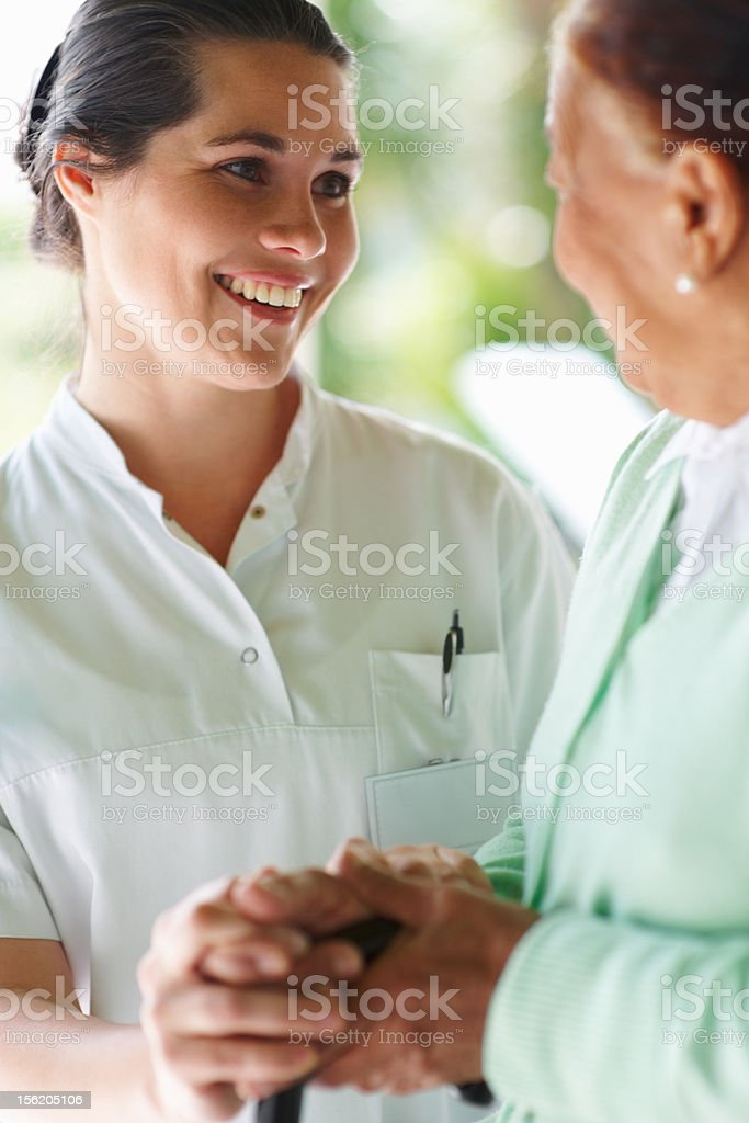 Happy nurse speaking to a patient royalty-free stock photo