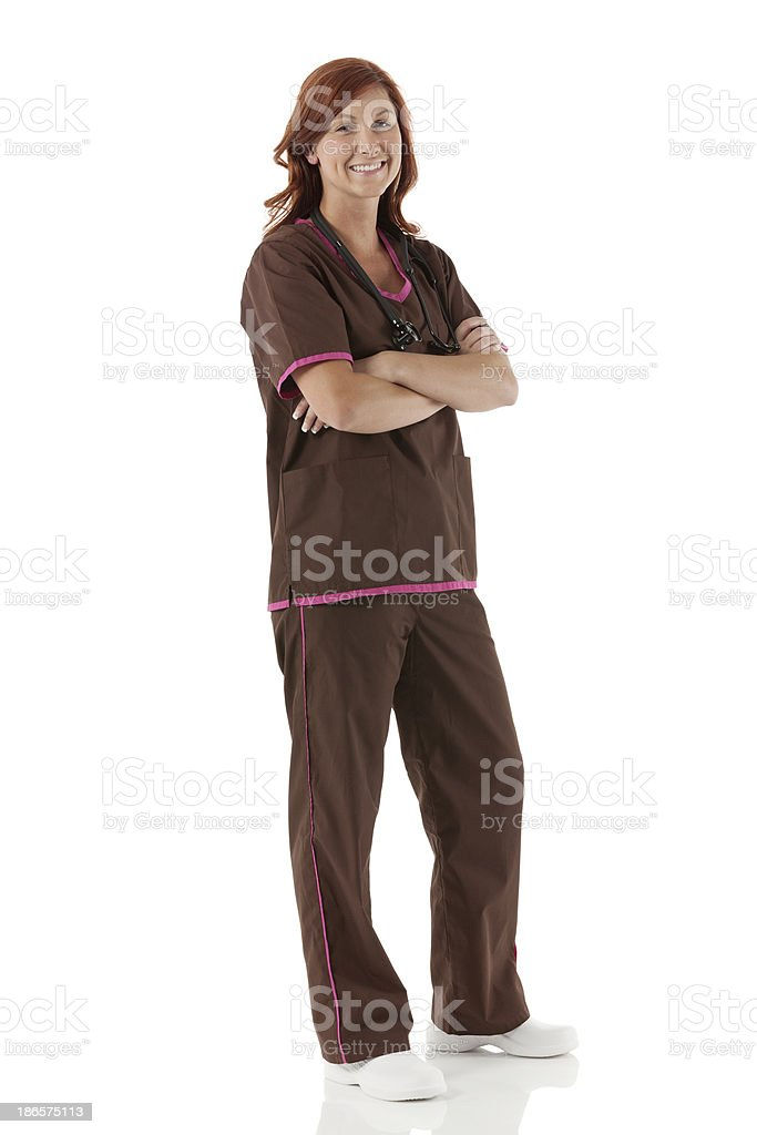Happy nurse standing with arms crossed royalty-free stock photo
