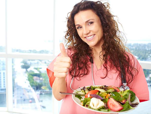 Happy Nurse With Salad stock photo