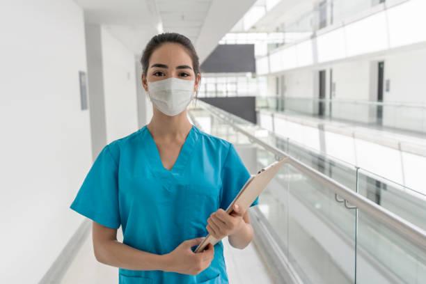 Happy nurse working at the hospital stock photo