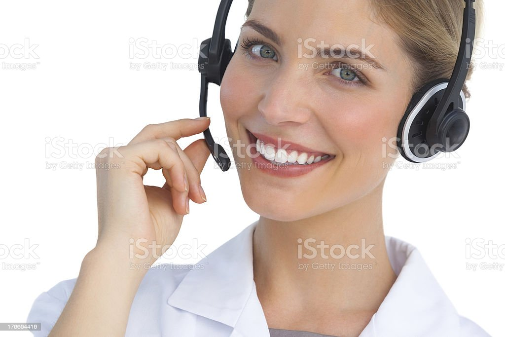 Happy nurse working with headset royalty-free stock photo