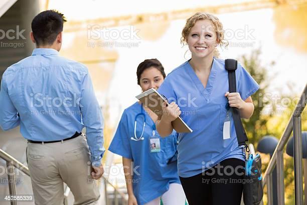 Happy nursing medical student walking to class on college campus picture id452585339?b=1&k=6&m=452585339&s=612x612&h=sgohxoi4kh sbdjutgqyzafj2jxiywxdoyd5 bbir2m=