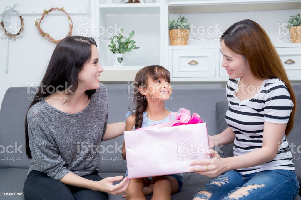 happy of mother and daughter woman asian and aunt with gift with pink ribbon and daughter kissing mother, Happy family concept. Happy mother's day. zbiór zdjęć royalty-free