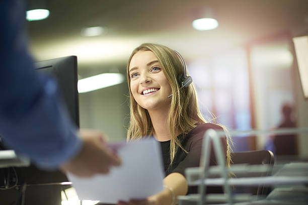 happy office intern - switchboard operator stock photos and pictures