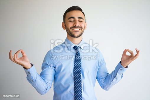 istock Happy Office Worker with Zen Gesture 899287812