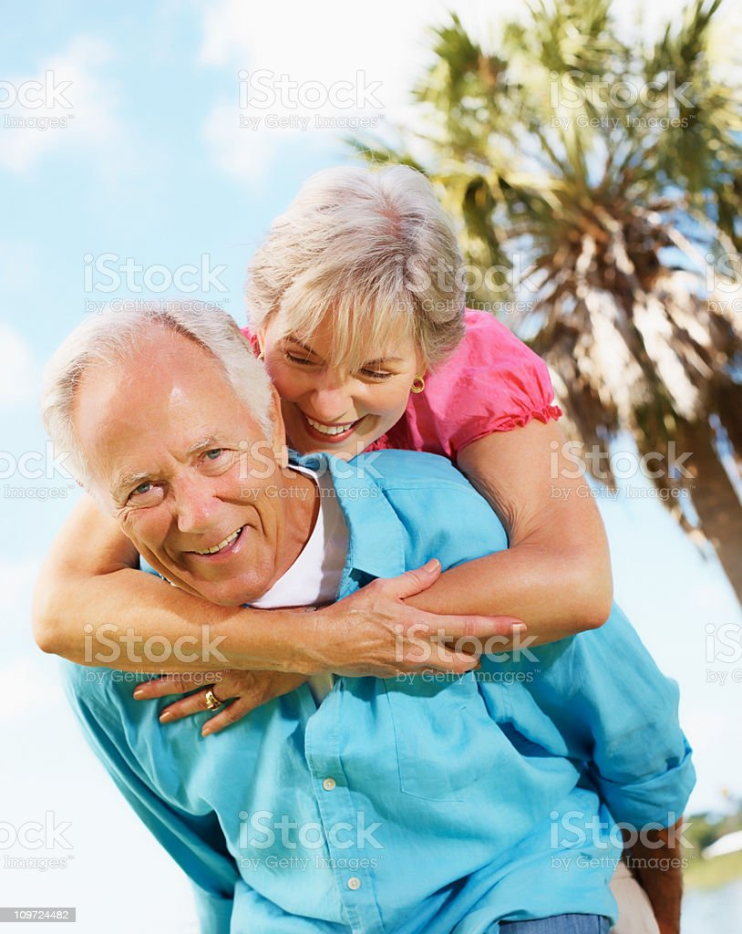 Happy, old couple enjoying their vacation royalty-free stock photo
