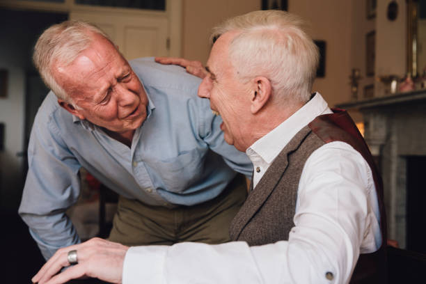Happy Old Friends Two senior men are laughing hysterically together. only senior men stock pictures, royalty-free photos & images