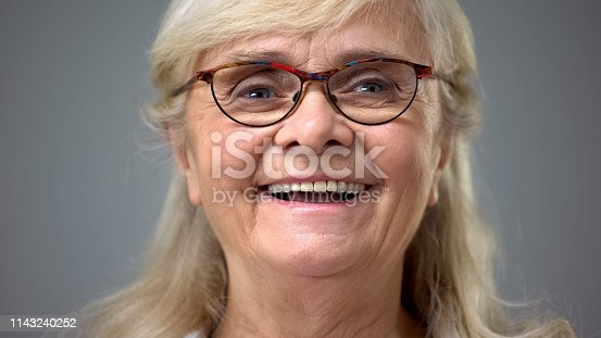 Happy old lady wearing eyeglasses, concept of ophthalmology, vision problems