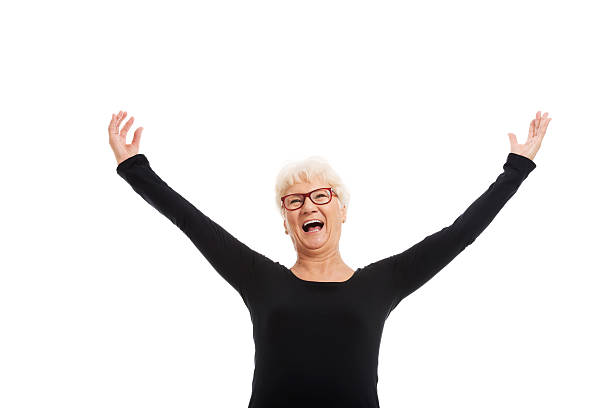 Happy old lady con aumento de las manos. - foto de stock