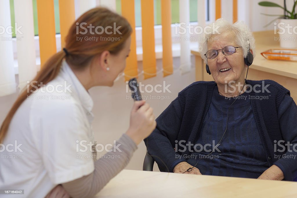 happy old woman during audiometry and medical test royalty-free stock photo