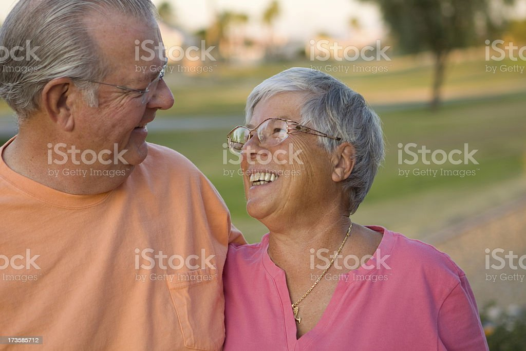 Happy Older Couple in Pastel stock photo