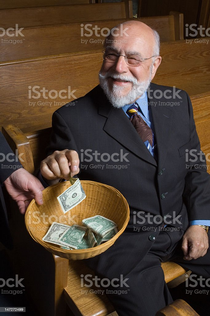 Happy Older White Man Making Donation Church Offering Basket Sitting stock photo