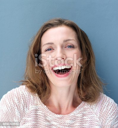 istock Happy older woman laughing 469043840