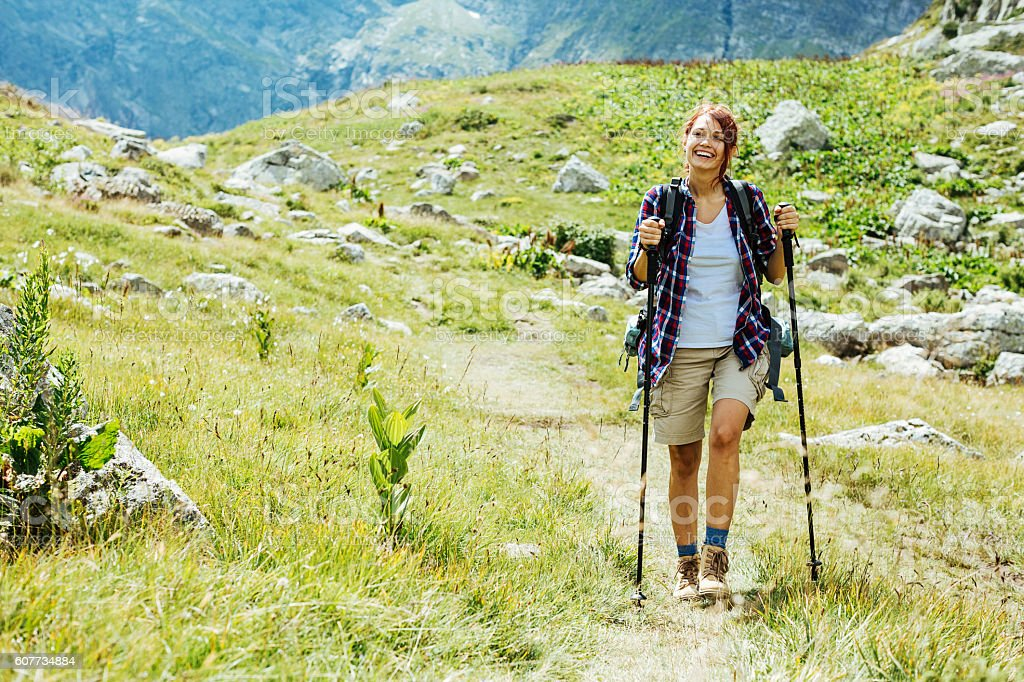 Happy on the mountain footpath stock photo
