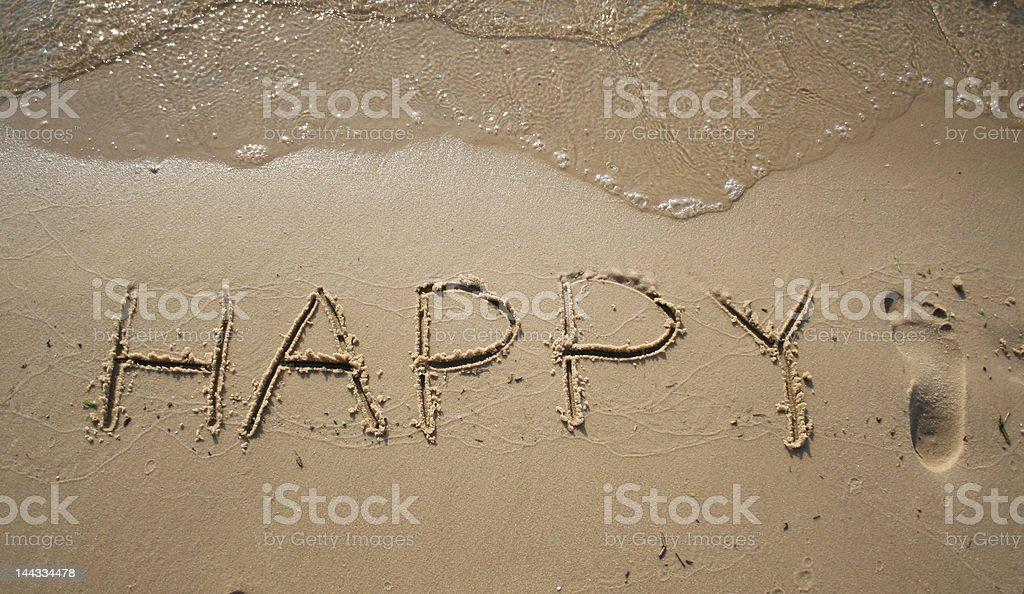 'Happy' on the sand stock photo