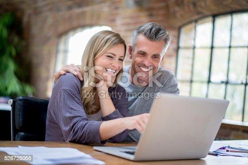 istock Happy online couple 526725055