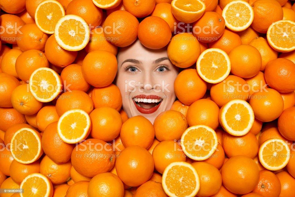 happy orange woman stock photo