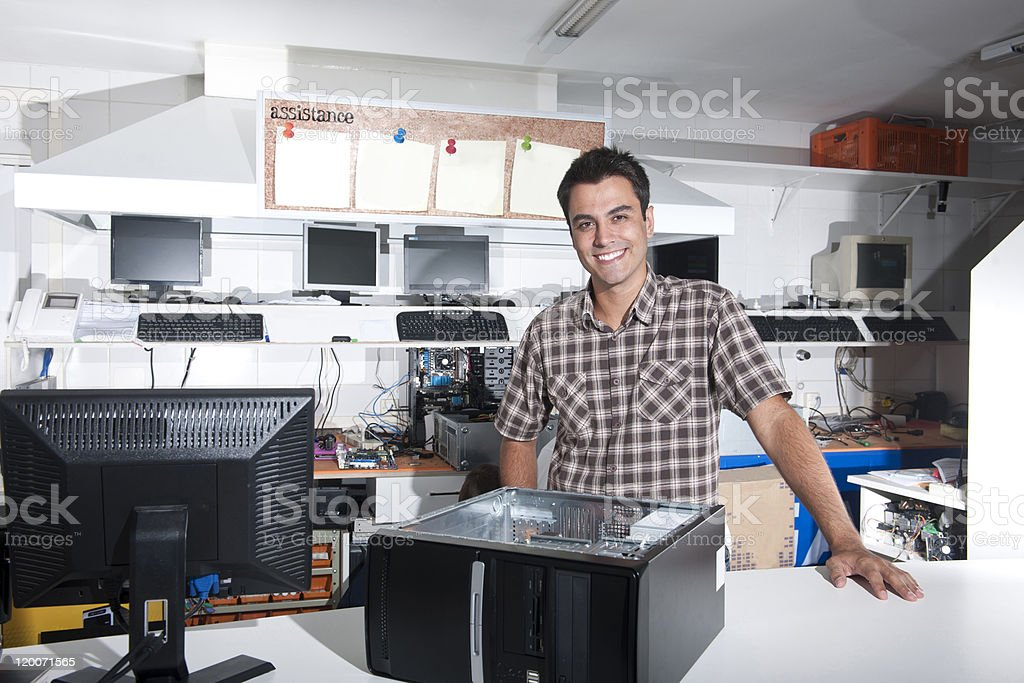 Happy owner of a computer repair store royalty-free stock photo