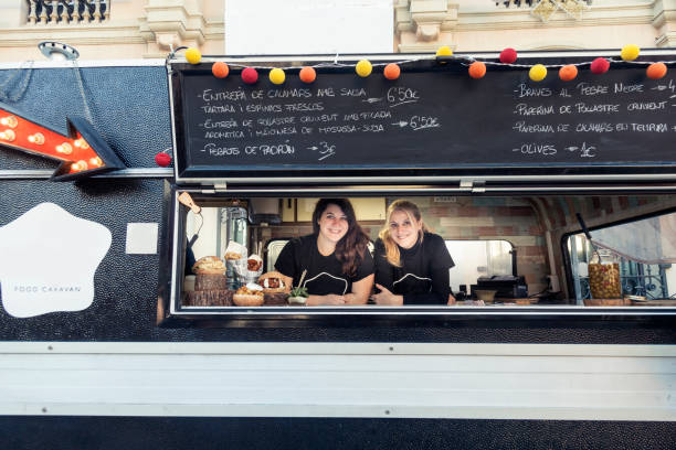 Happy owners in a food truck stock photo