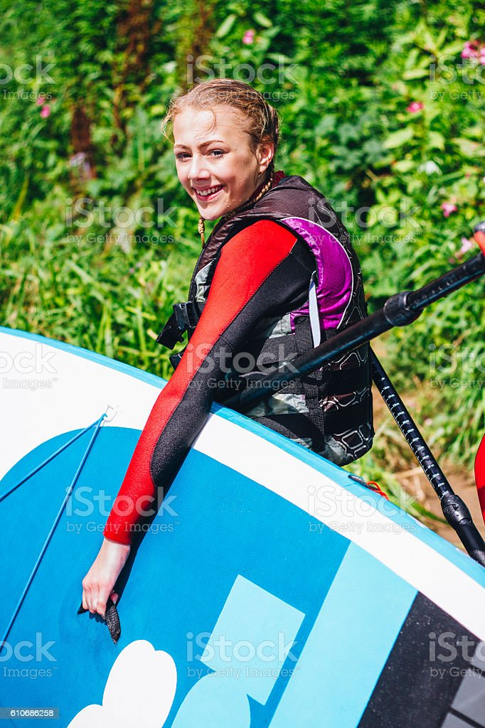 Happy Paddleboarder stock photo