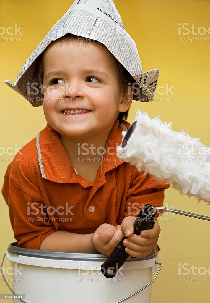 Happy painter with newspaper hat royalty-free stock photo