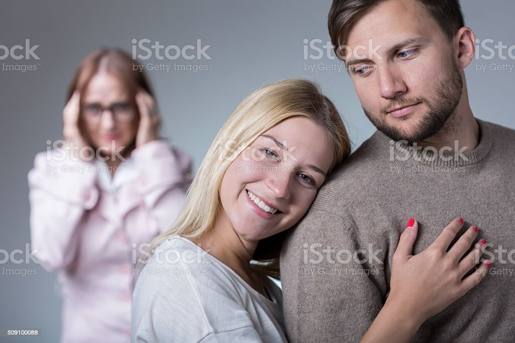 Happy pair and overprotective mother stock photo